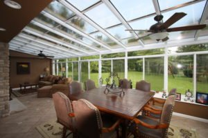 Patio enclosure with windows and table set